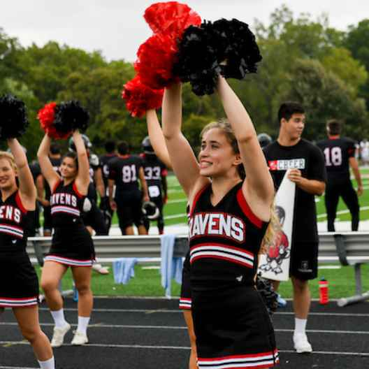 Cheerleaders cheering at a football game