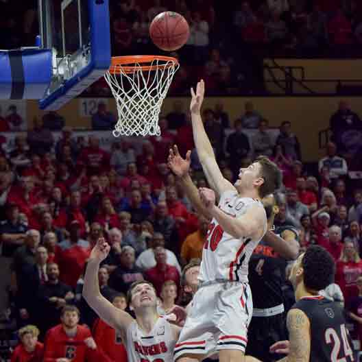 A Benedictine College Men's Basketball player makes a basket