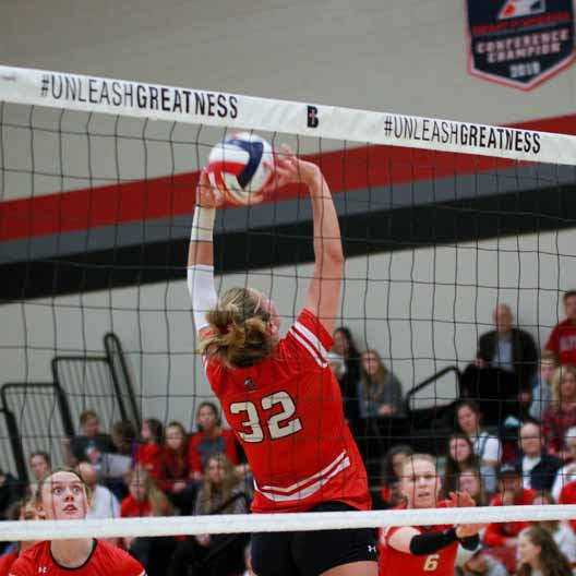 A Benedictine College Volleyball player setting the ball