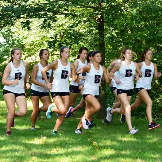 Lady Ravens cross country team running in a pack