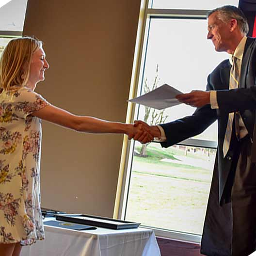 Head of the department giving a student an award