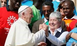 Sister Norma Pimentel, MJ grasps the hand of Pope Francis
