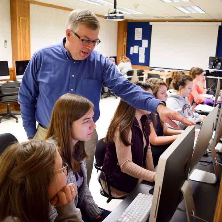 Students in a computer lab with Dr. Kevin Page